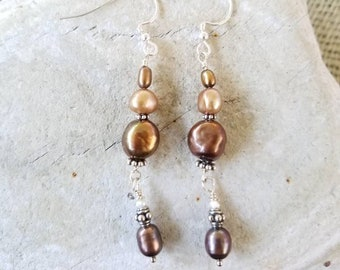 Dancing Pearl Earrings.  Chocolate, Champagne and Bronze Iridescent Pearl's dance on silver ear wire set apart with Bali Daisy spacers.