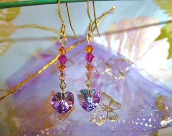 Small heart-earrings of Swarovski Crystal and heart Swarovski Crystal beads in purple with multiple reflections.