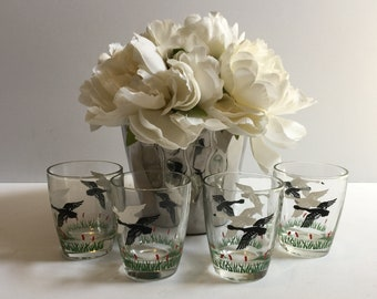 Set of Four (4) Vintage Mid Century Low Ball Glasses with Black and White Flying Geese and Colorful Cat-O-Nine-Tails