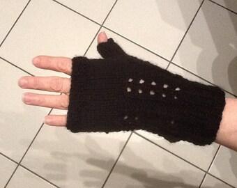 Pressed black fingerless gloves by hand.