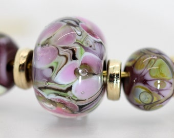 Nine Bead Set  - Violet, Pink, and Lime. Encased Floral Plus Eight Companion Beads