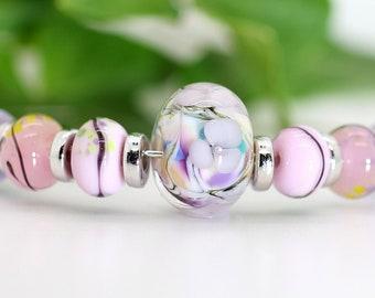 Nine Bead Set  - Pastel Pinks. Encased Floral Plus Eight Companion Beads
