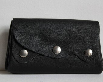Wallet, accordion, items in black leather card holder