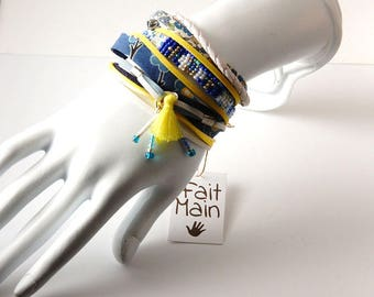 Multi-row woman yellow cuff and white - ribbons and leather