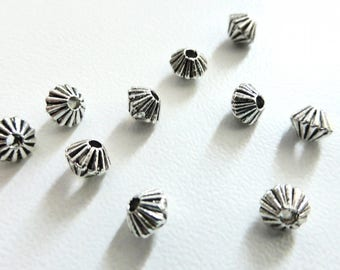 50 small beads in antique silver PMA52