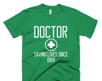 Happy National Doctors' Day Short-Sleeve T-Shirt Saving Lives Since 1984 Shirt Doctors day T-Shirt Funny Doctors Day Gift tee gift for docto
