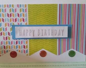 Multicolored happy birthday handmade greeting card.