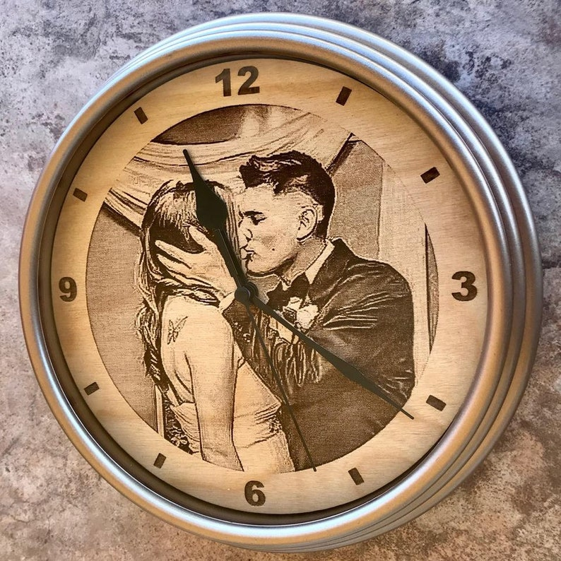 """If you want to remind your partner of your love time. You can buy him or her an engraved wooden photo clock. This rustic gift made by modern tech can be used to decorate the wall. And every moment your other half wants to check the time, your photo will call back """"your time"""" first."""