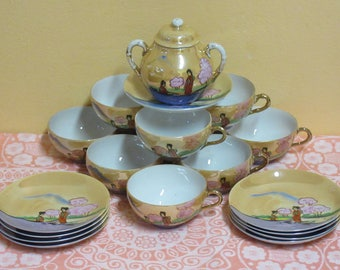 Vintage Set of Japanese Translucent Eggshell Porcelain Tea Cups and Saucers with a Sugar Bowl/Pot with Lid (19 pieces)