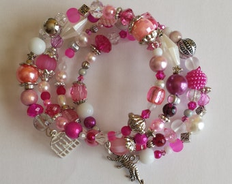 Bracelet 4 row memory wire - glass beads and acrylic pink tones