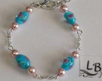 Bracelet - lampwork beads blue/pink and Pearly pink round beads