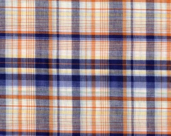 Plaid shirting in navy and orange.  Cotton poly blend.  Excellent quality vintage