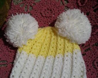 Crochet baby hat with double pom pom