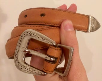 brown leather belt, silver buckle
