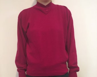Vintage raspberry merino wool sweater with button detail at collar