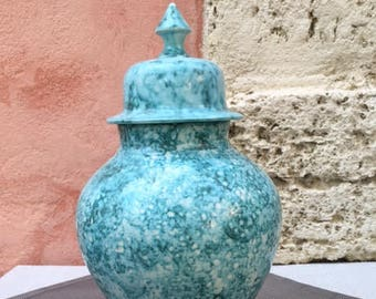 "Ceramic vase glazed in blue/green effect ""sea"", with a lid."