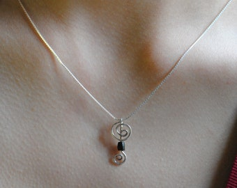 Wood bead and silver spiral pendant necklace