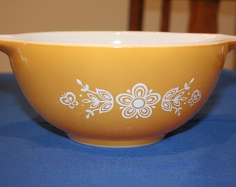 Yellow Pyrex Mixing Bowl with White Flowers