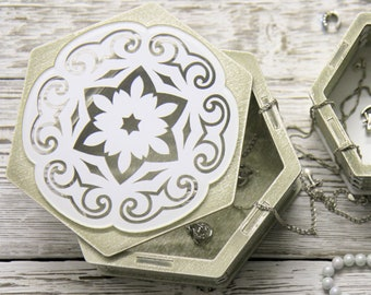 Casket for jewelry. Jewelry box with application. Wooden jewelry box