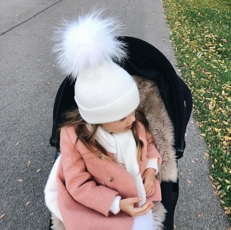 White hat with fur pom