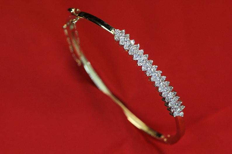 Diamond and 14k Gold Hinging Bangle Bracelet with Security image 0