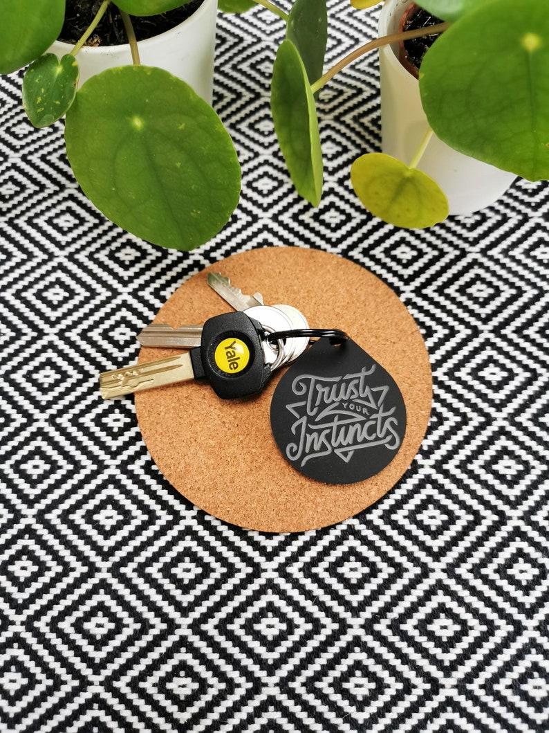 Trust Your Instincts Motivational Black Plastic Keyring MCR image 0