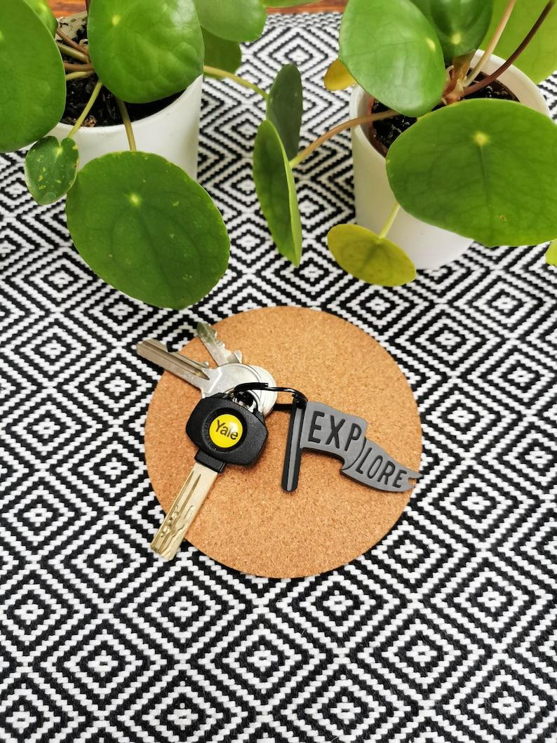 EXPLORE Travel Black Plastic Keyring MCR Keychain image 0