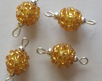 4 seed connectors (2.5 mm) Gold lined beads