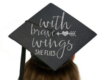 With Brave Wings She Flies Graduation Cap Iron-On Decal