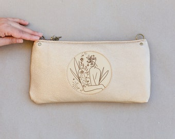 Engraved leather bag with floral ornaments and feminine motif, as a party or evening bag, celebrate femininity