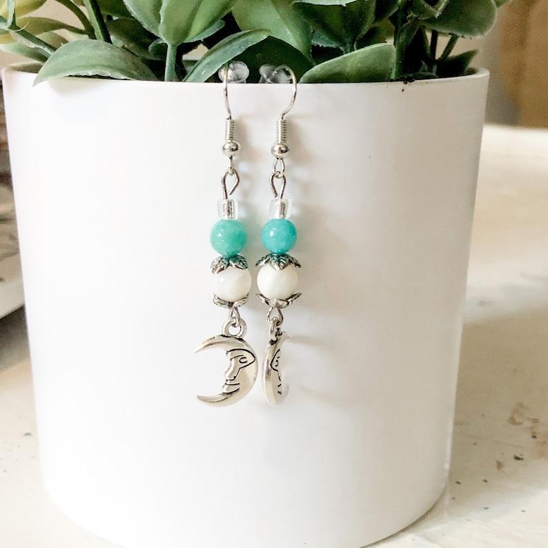 and silver moon dangle earrings. Teal cream