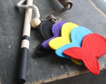 Magnetic fishing rod / wood / black / purple, red, aqua, black and yellow fish