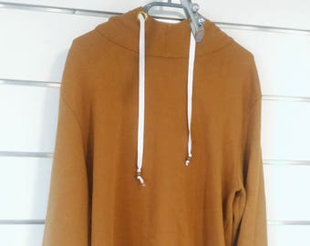 FOREST is a caramel brown hooded sweatshirt.