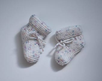 Booties and knitted hat, girls between 0-3 months