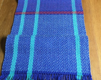Handwoven table runner in blue and turquoise