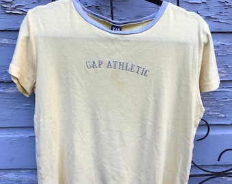 SALE!  vintage Gap athletic graphic tee/ size medium /pastel yellow/ 50% off original price of 20 dollars