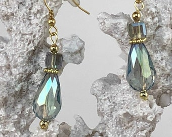 Beautiful crystal blue earrings reflect the sparkling blue waters of the Caribbean sea.