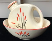 Two Vintage Universal Potteries Sears Roebuck Co. Cattails Pieces, Water Jug and Serving Bowl