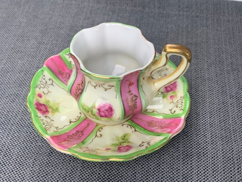 Celebrate Made in Occupied Japan Tea Cup and Saucer c Hand Painted Floral decorations,Gold Gilt 1940s Demitasse