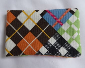 Oyster card holder with a Plaid pattern fabric. Great for housing a bus pass too!