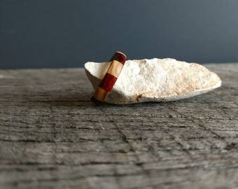 One of a kind stainless steel ring with Bethlehem olive wood and padauk segmented overlay