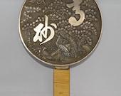 Antique Meiji period Japanese metal Kagkimi hand mirror with embossed scene