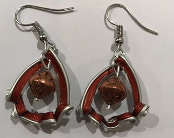 Unique and elegant pearled earrings featuring a brown recycled Nespresso capsule.