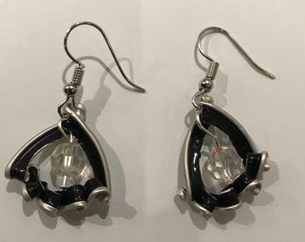 Unique and elegant pearled earrings featuring a purple recycled Nespresso capsule.