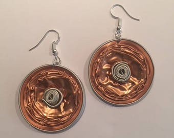 Unique earrings featuring a Nespresso stud and 2 recycled Nespresso capsules.