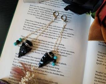 Dangle obsidian arrow head earrings.
