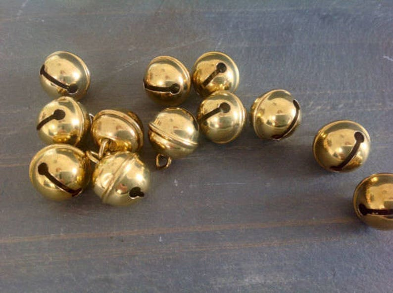 POLISHED BELLS in two sizes with brass finish and eyelet