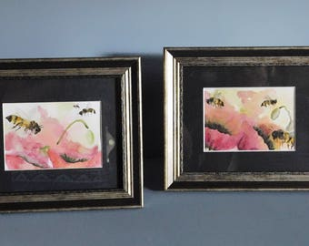 Framed pair of watercolor, hand-painted bees on poppies