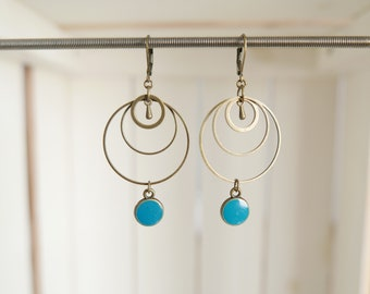 Earrings in antique brass and turquoise epoxy resin