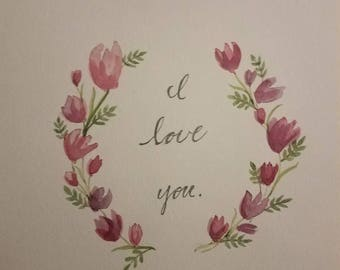 "Dainty little floral wreath-- ""I love you."""